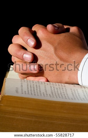 A close up of a pastor praying - stock photo