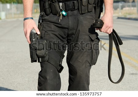 A close up of a police K9 dog handler's equipement - stock photo