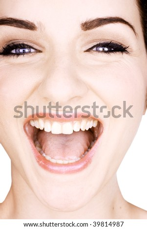 A close up of a pretty woman laughing on a white background. - stock photo