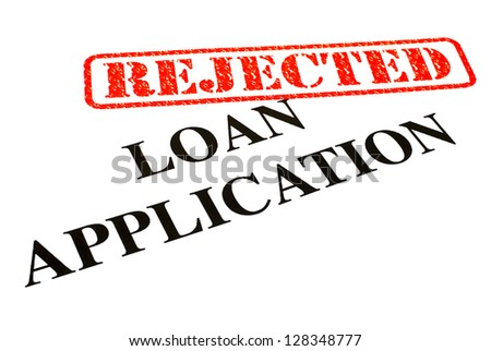 A close-up of a REJECTED Loan Application document. - stock photo