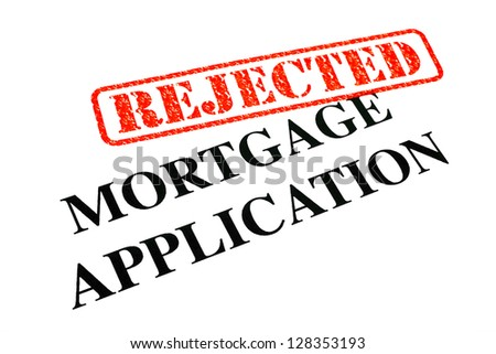 A close-up of a REJECTED Mortgage Application document. - stock photo