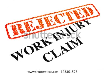 A close-up of a REJECTED Work Injury Claim document. - stock photo