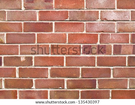 A close up of a section of a red brick house wall. - stock photo
