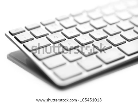 a close up of a white computer keyboard - stock photo