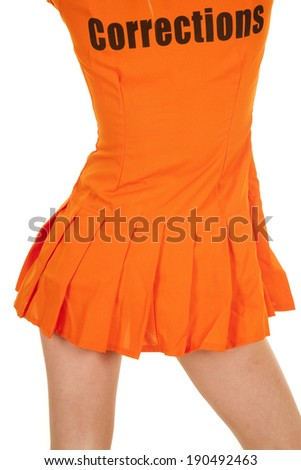 A close up of a woman's back in her orange jump suit. - stock photo