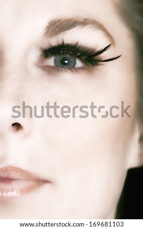 a close up of a woman's eye - stock photo