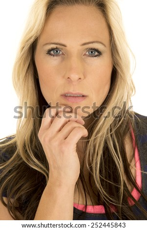 A close up of a woman with a serious expression on her face. - stock photo