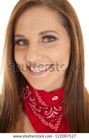 a close up of a woman with a smile on her face wearing a red bandana. - stock photo