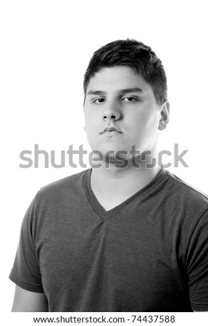 A close up of a young man with a very serious look on his face. - stock photo
