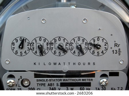 A close-up of an electric meter. - stock photo