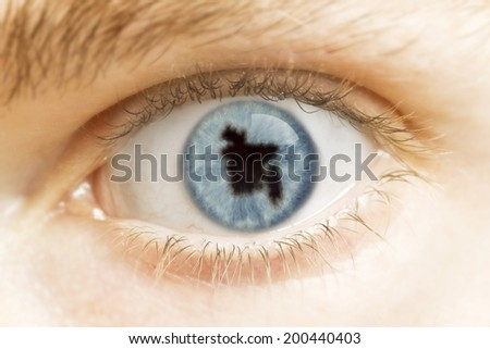 A close-up of an eye with the pupil in the shape of Bangladesh.(series) - stock photo