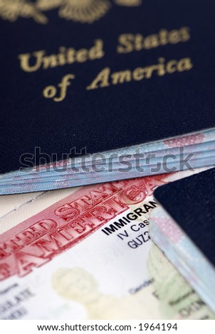 A close up of an Immigrant Visa and US passport - stock photo