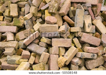 a close up of an old pile of bricks - stock photo