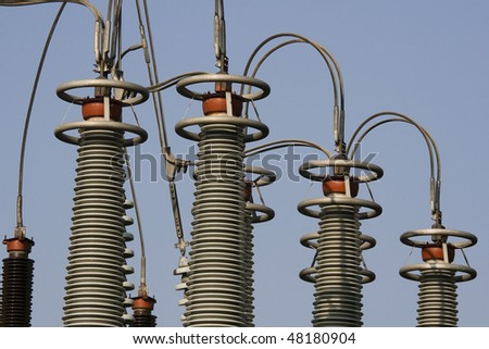 A close up of detail on a pylon.  This part of the pylon is most probably insulators. - stock photo