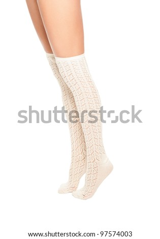 a close up of female legs with stockings - stock photo
