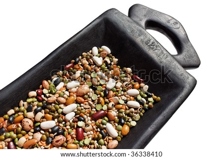 A close up of mixed beans in a black wooden container. - stock photo
