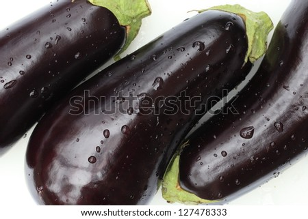 A close up of rinsed eggplant - stock photo