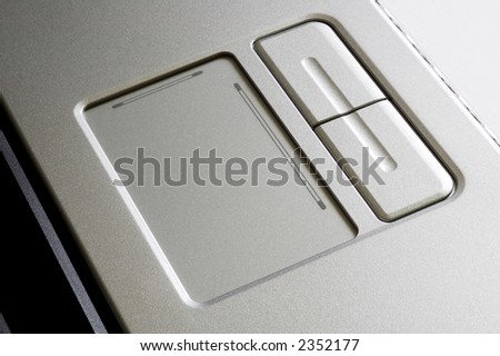 A close up of touch pad of laptop - stock photo