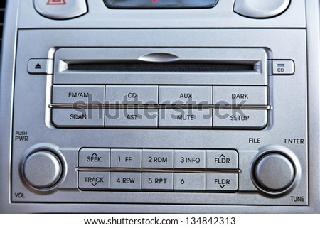 A close up on a metallic-gray colored radio and CD player. - stock photo