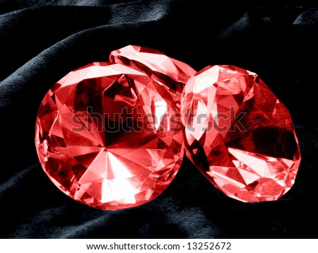 A close up on a Ruby jewel on a dark background. Shallow DOF. - stock photo