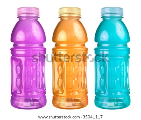 A close up on a set of isolated sports drink bottles. - stock photo