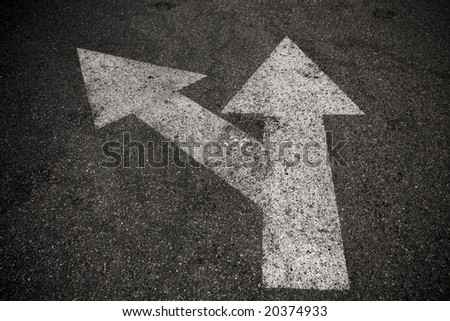 A close up on an arrow on pavement. - stock photo