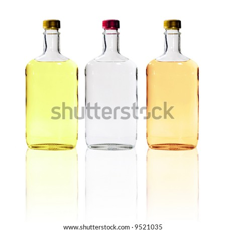 A close up on bottles of alcohol isolated on a white background. - stock photo