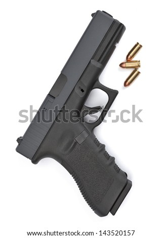 A close-up overhead view of a pistol and ammo isolated on a white background - stock photo
