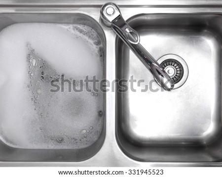 A close up photo of double kitchen sink - stock photo