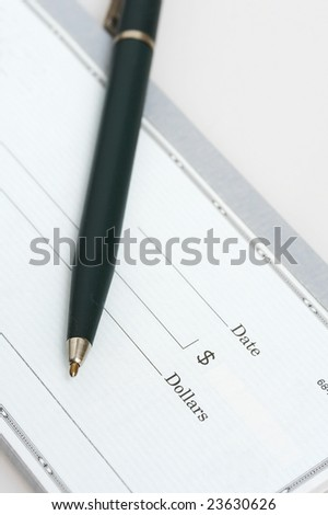 a close up picture of a pen and check - stock photo