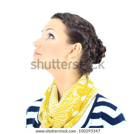 A close-up portrait of a beautiful woman with a yellow scarf. Isolated on a white background. - stock photo