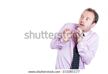 A close-up portrait of a man, businessman, executive, corporate employee, looking shocked, scared trying to protect himself in anticipation of an unpleasant situation, isolated on a white background - stock photo