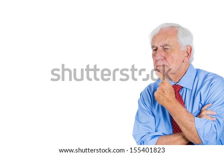 A close-up portrait of a senior executive, grandfather, deep in thought, looking troubled and concerned, sad, depressed, isolated on a white background with copy space. Human emotions, expressions. - stock photo