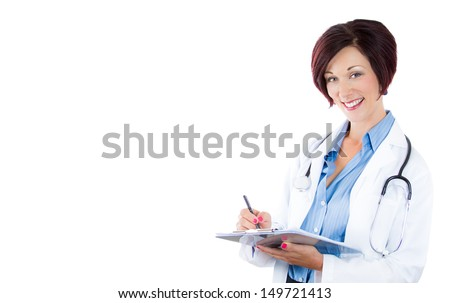 A close-up portrait of a smiling woman doctor taking patients notes and looking at you, isolated on a white background  with copy space  - stock photo