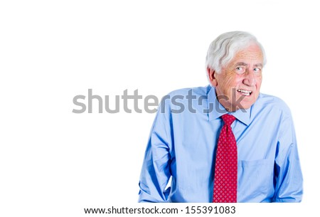 A close-up portrait of an elderly executive man, looking unhappy and annoyed,having trouble hearing his opponent, during unpleasant conversation, isolated on a white background with copy space. - stock photo
