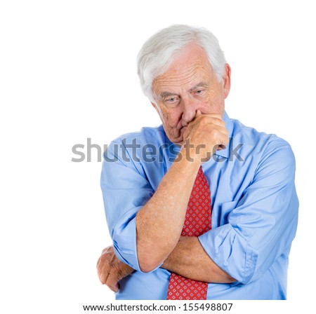 A close-up portrait of an elderly executive, old corporate employee, grandfather, senior man deep in thought, troubled with something, sad and concerned, isolated on a white background  - stock photo