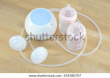 A close up shot of a breast pump - stock photo