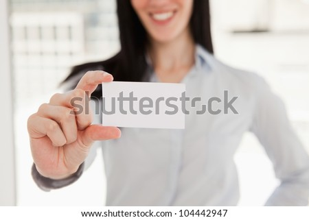 A close up shot of a business card in the hand of a woman - stock photo