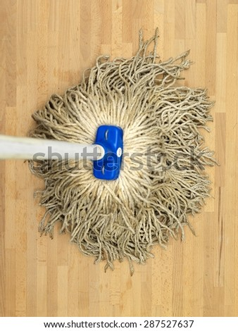 A close up shot of a environmentally friendly floor mop - stock photo