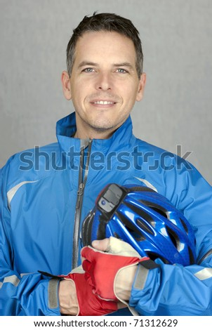A close-up shot of a healthy, confident cyclist looking to camera. - stock photo