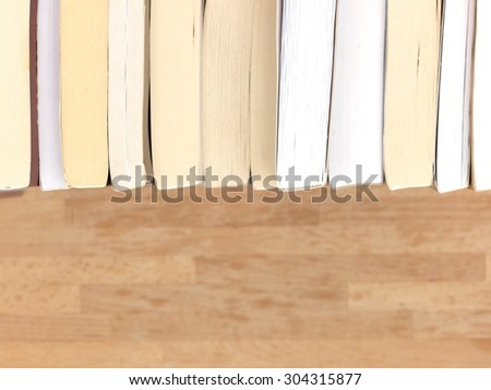 A close up shot of a pile of books - stock photo