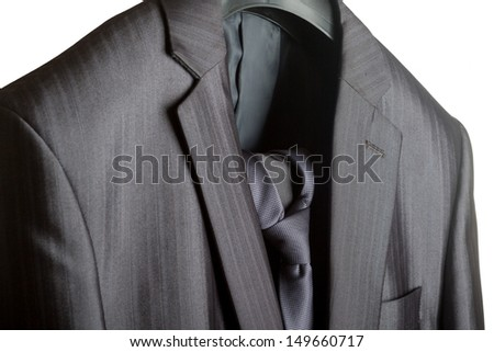 A close-up shot of an elegant formal mens suit with a tie - stock photo