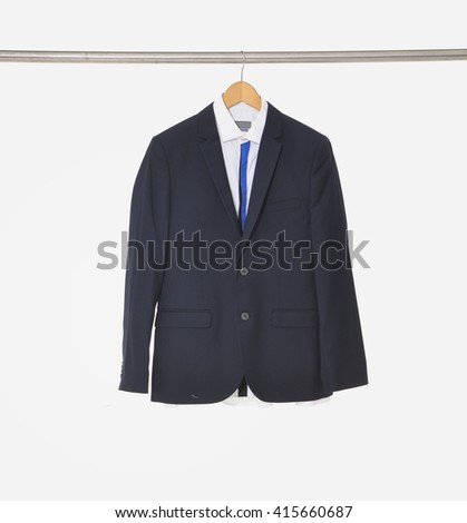 A close up shot of business man suit clothes hanging - stock photo
