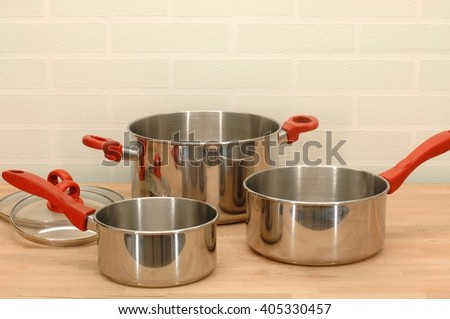 A close up shot of kitchen pots and pans - stock photo