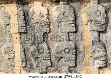 A close up shot of the Wall of Skulls at Chichen Itza in the Yucatan, Mexico - stock photo