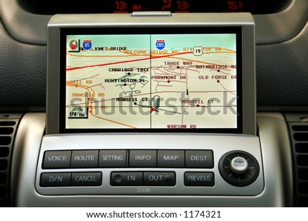 A close-up view of a GPS vehicle navigation system inside a car. - stock photo