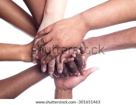 A close up view of a large group of people of mixed races and genders holding hands in a supportive manner. - stock photo