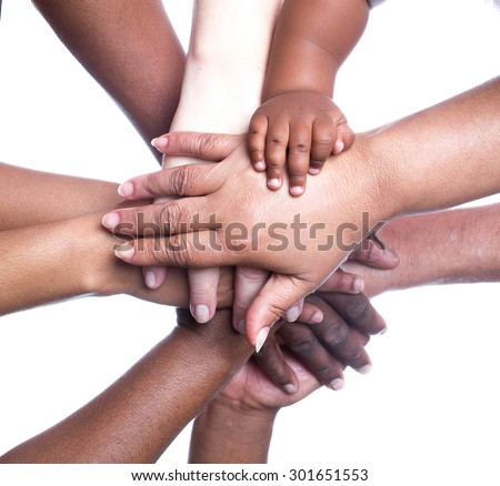 A close up view of a large group of people of mixed races, genders and ages holding hands in a supportive manner. - stock photo