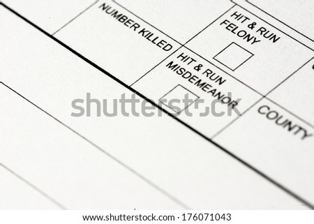 A close up view of a traffic collision report form. - stock photo