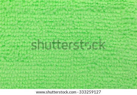A close view of a lime green microfiber sponge  - stock photo